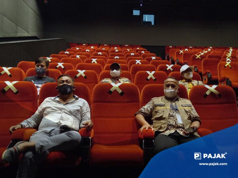 Tips Aman Kembali Nonton di Bioskop saat PPKM